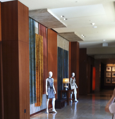 Here is our first lobby scene. With the help of interior designer Julie Jomo, we hung yards of hand printed fabric which  swayed with the movement of passers by to the delight of hotel guests. Two mannequins always wore our current designs, here are our Identity pieces from our launch runway show at Lincoln Center Sept 2009.