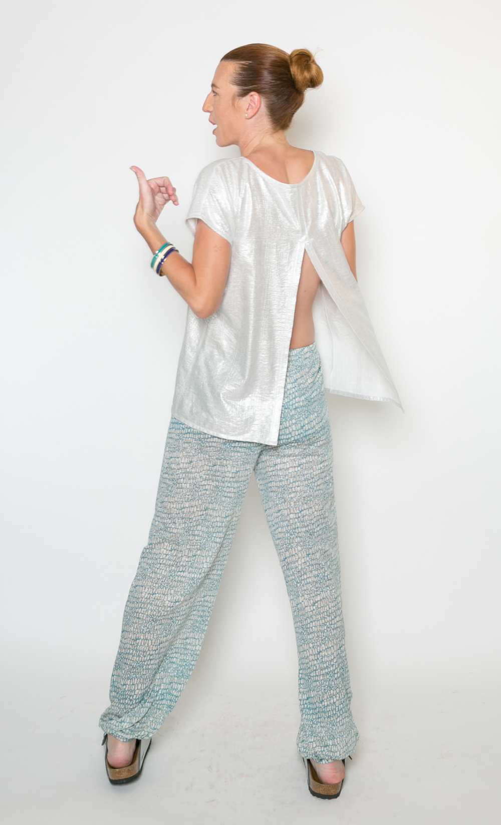"Sparkle Contemplative Top  #P44P6-26 Sparkle Contemplative Top   $49 #P44P6-32 Sparkle Contemplative Top   $49 Back Button Top, 26"" or 32"" length Silver Sparkle (Rayon/Poly) (Also in Organic Cotton Bamboo solids: Aqua, Black, Navy, Sand, White and Prints) Size XS - XL Gentle Wash Cold, Dry Flat Designed & Sewn in USA   Om Pant      T5583  Organic Cotton Rayon Bamboo     $49 N5583 100% Linen Knit                                   $64 Draped Jogger Pant Self Fabric Cuff   32"" Inseam Aqua & Sand Ovals   (Also in solid: Aqua, Black, Navy, Sand, White, Charcoal, Everglade, Fog, Lake, Lipstick, and all Prints)  Size XS - XL Gentle Wash Cold; Hang to Dry   NOTE:  Om Pant was photographed in Aqua Stripes 100% Linen Knit,  production will be 100% Linen Knit AND 55% Organic Cotton/45% Rayon Bamboo Slub from China. The top will still be cut and sewn in USA."