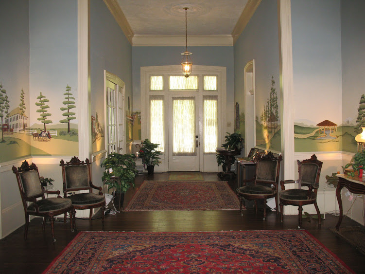 The painted murals in the museum's foyer depict important historic Lincoln Parish events. Visitors to the museum can now see these events come to life by listening to audio recordings from the actual individuals who have ties to each event.