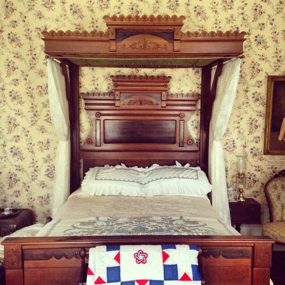 A bedroom on the museum's first floor showcases period furniture.