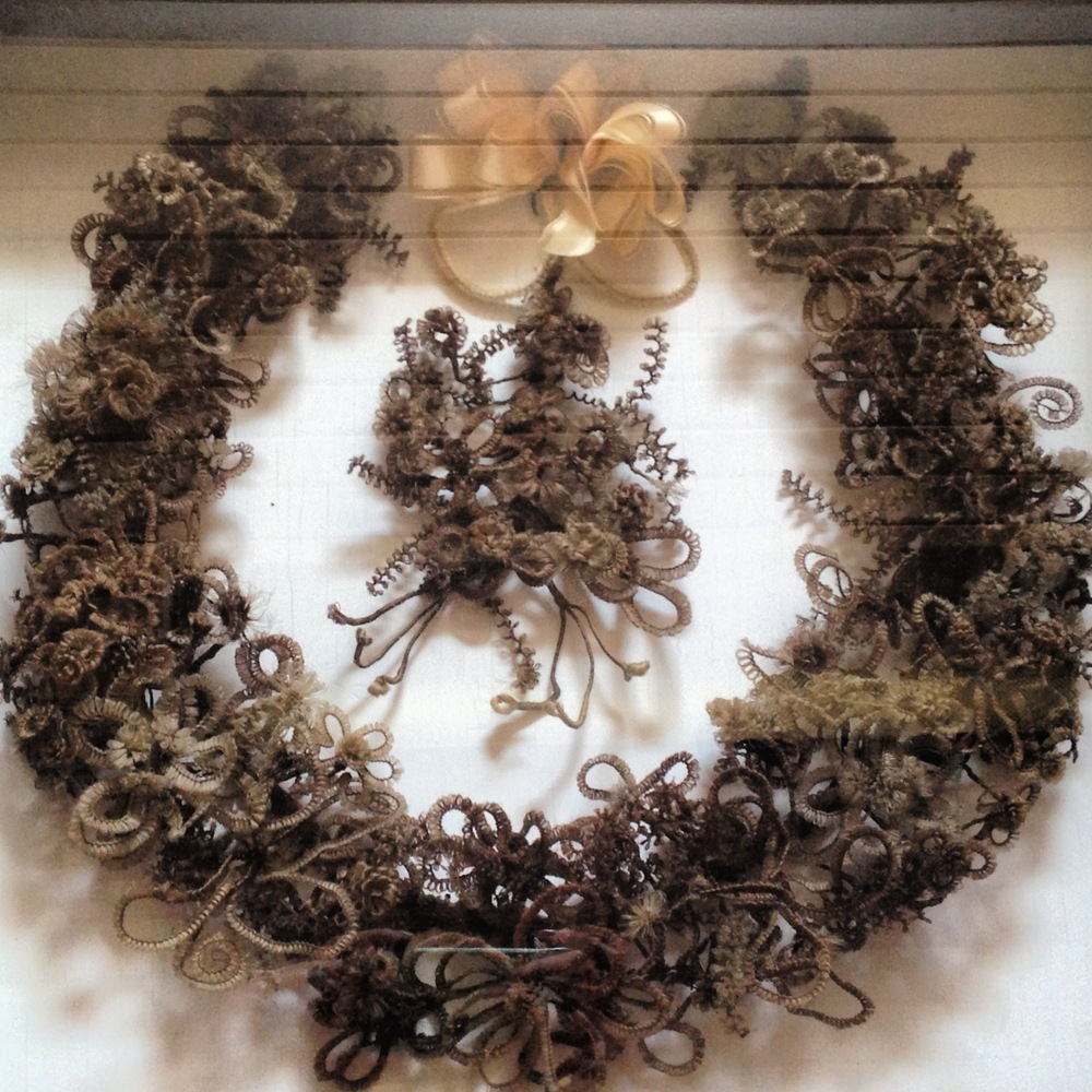 A mourning wreath crafted from human hair, made popular during the Victorian era.