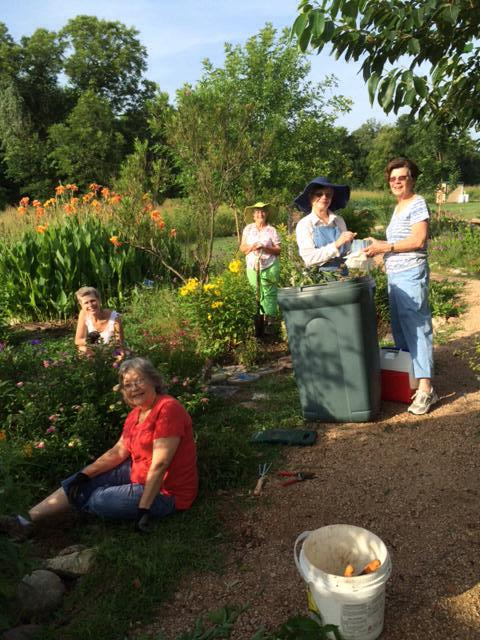 Cleaning up the garden...Scottie Davis, Debbie Urquhart, Carolyn Sander, Twila Tate. Ann Lehmann serving Cookies.