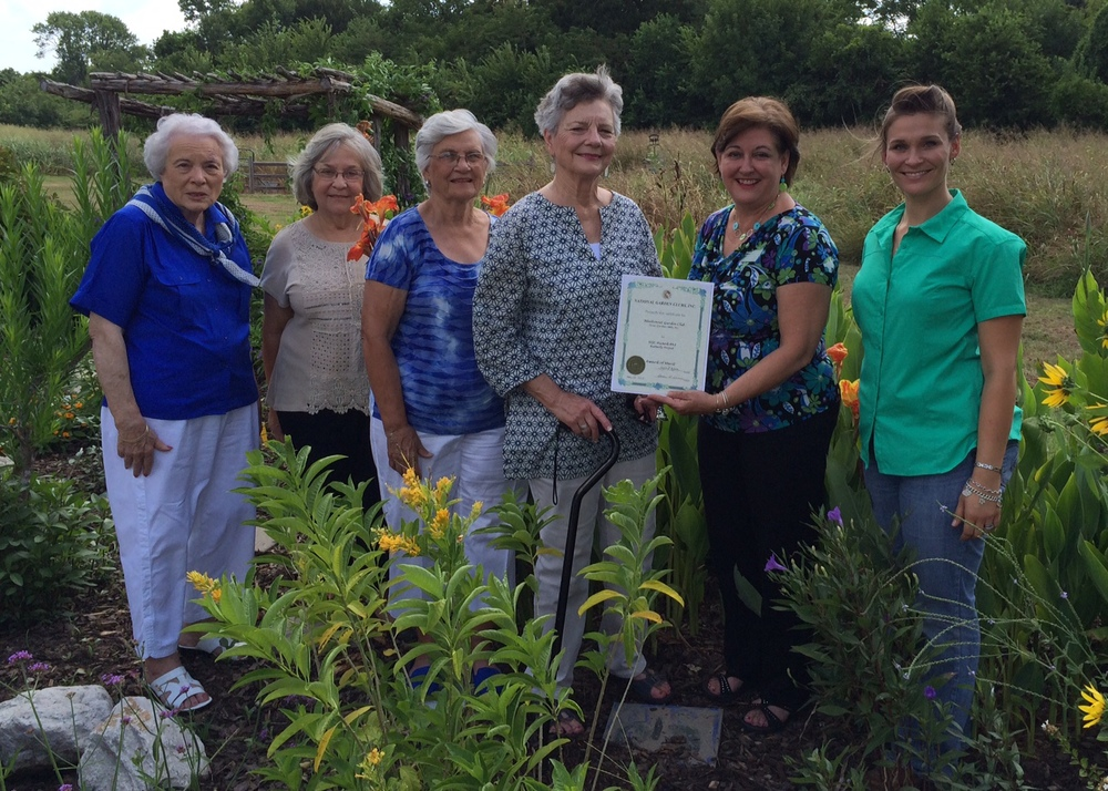 "Bluebonnet Garden Club of Brenham was the overall winner of National Garden Club, Inc. Butterfly Project Award. This Certificate of Merit in honor of Dean Day Sanders includes $500 awarded to the club conducting the most comprehensive and effective project on butterflies for habitat protection, protection of migratory routes and public education. The club was commended for working with youth and adults in establishing and maintaining a Butterfly Garden at Brenham Elementary School. Some of the comments accompanying the award are that it is part of an outdoor classroom/nature trail available to all students and a welcoming place for butterflies. The fact that plants, labels, and information stating ""host plant' or ""nectar plant"" which are helpful to all learners was another positive remark.  Members of the club maintain the garden with help from all the Brenham Elementary School fourth graders each year. These students are organized as a youth garden club, Brenham Elementary Gardeners. The sponsoring club attempts to help students understand the life cycle of butterflies, create an appreciation of nature and our impact on the environment, and instill a lifelong love of gardening. The junior garden club learns about butterflies and gardening .through observation and hands-on gardening. In addition, members of Bluebonnet Garden Club work with other groups as part of the Outdoor Learning Center on community days and days when students from other schools are brought to the school for an outdoor day.  Members of Bluebonnet Garden Club Youth Gardening Committee are pictured in the Butterfly Garden presenting a copy of the award to Bonnie Brinkmeyer, Director of Instruction and Accountability for Brenham I.S.D. and Natalie James, Outdoor Learning Specialist.  Straight from the National Garden Club site... What an outstanding award and recognition! Great job, ladies!!  ""#43 BUTTERFLY - In honor of Deen Day Sanders - $500 donated by Alice and LeRoy Overton OVERALL WINNER - Bluebonnet Garden Club, Brenham (Aii) TX This club works with Youth and adults to establish and maintain a Butterfly Garden at an Elementary School. It is an outdoor classroom/nature trail available to all students and a welcoming place for butterflies. Plants, labels, and info stating 'host plant' or 'nectar plant' are helpful to all learners."""