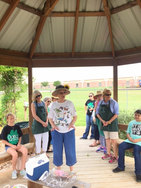 Twila Tate, Youth Gardening Chairman, talks to the students about what is happening in the garden in the Spring of the year.
