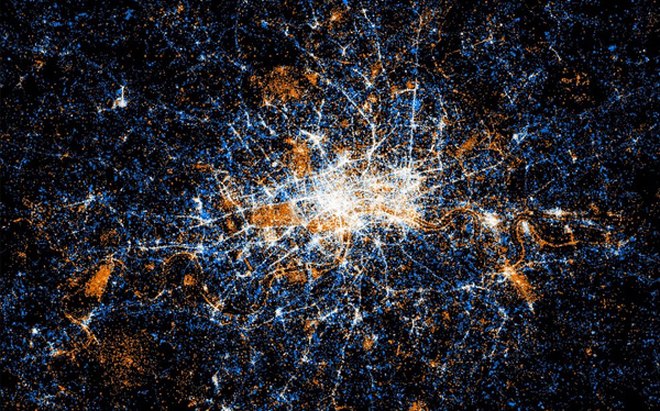London: Red dots represent Flickr pictures while the blue dots are tweets. The white dots are locations that have been posted to both. The map, created by Eric Fischer, reveals Twitter is used across the city of eight million people, while geo-tagged Flickr snaps are clustered south of the River Thames.