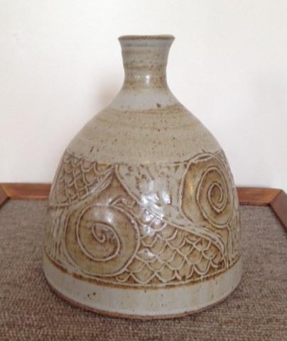Carved stoneware vase