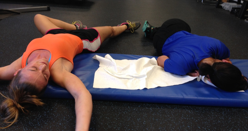 "Here are two of my clients post workout.  These chicks work hard! They do 6:00 minute planks ""for fun"" after their workout.  Next on the to do list: eat and rest!"