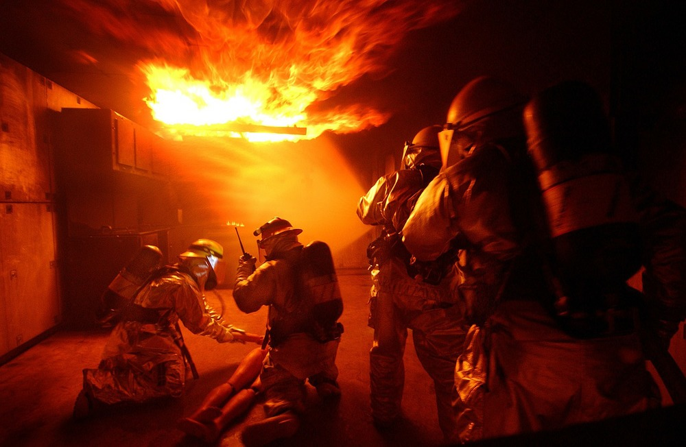 Firefighters during live fire drills.  Photo available at  pixabay.com  under  CC BY 1.0.