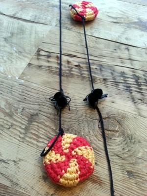 I attached the candies to yarn, just like in the game, and made little pom-pom spiders with twist tie legs for decorations. The wire in the legs was too sharp for them to be played with.