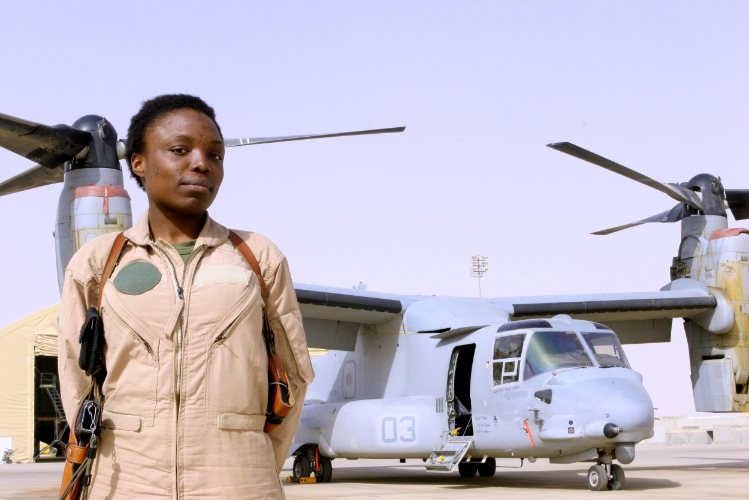 Captain Elizabeth A. Okoreeh-Baah, the first female  MV-22 Osprey  pilot, stands on the flight line in Al Asad, Iraq after a combat operation on March 12, 2008. Wikipedia.