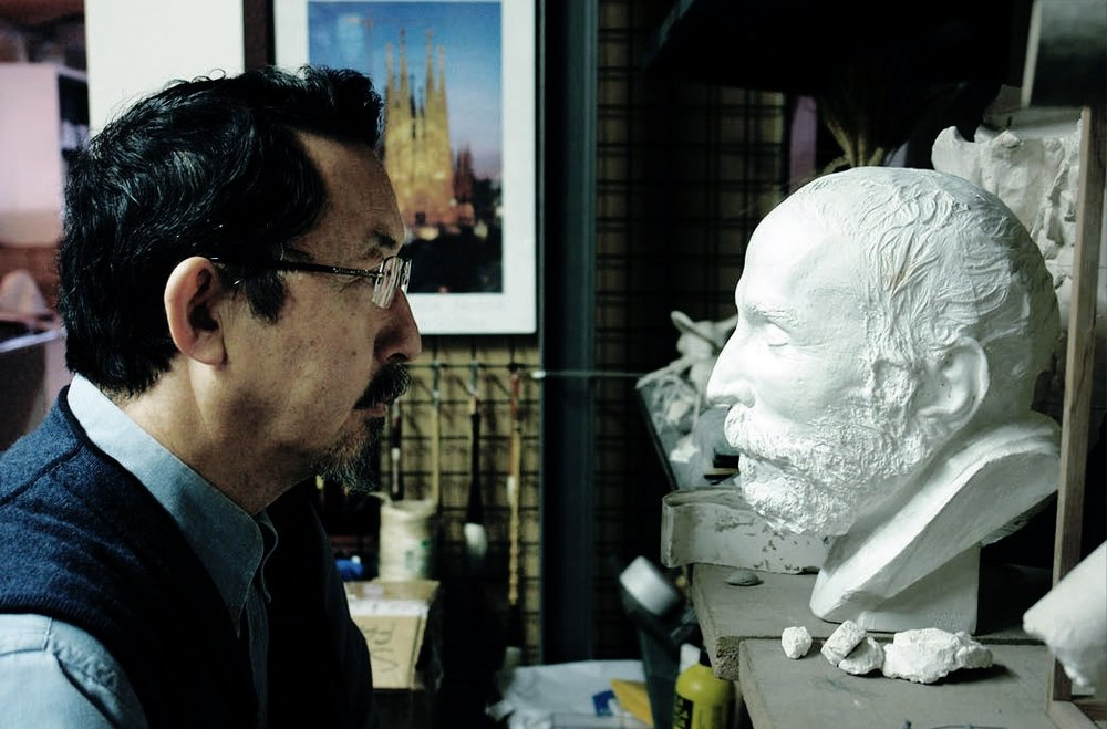 "The Sculptor Etsuro Sotoo in his Studio with Gaudi's death mask: ""One day, as I was in front of Gaudi´s thomb, I heard a voice. ""The voice said to me: Dont´ look at what I have done, look at that what I would look at. Since them I speak everyday to Gaudi. He gave a path that I could follow. Now I have the formula to interpret  and continue Gaudis work."""