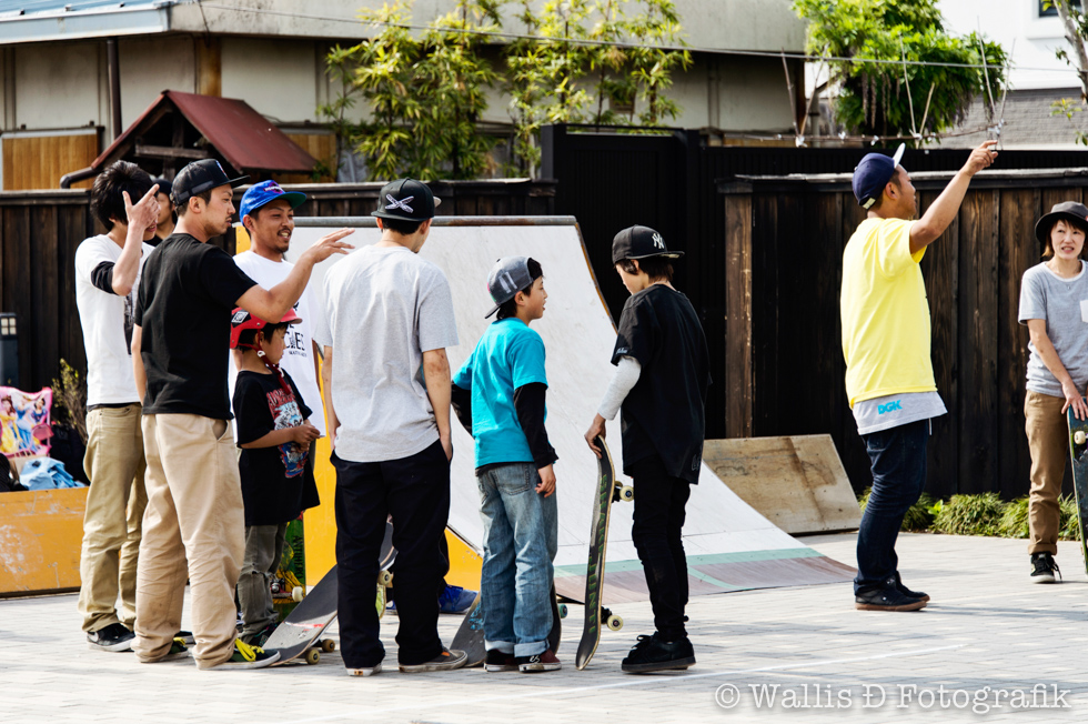 Takuya (black shirt on the left) organising the mixed age teams for one of the relay events.