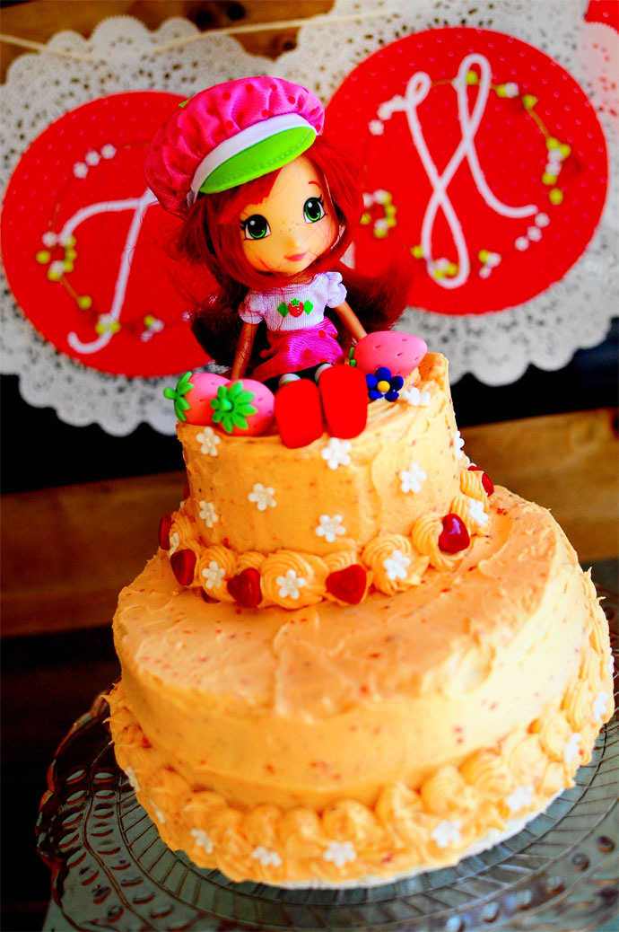 Sweet and whimsical strawberry themed birthday party cake