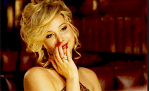 "Jennifer Lawrence's character sniffing her nail polish in ""American Hustle"""