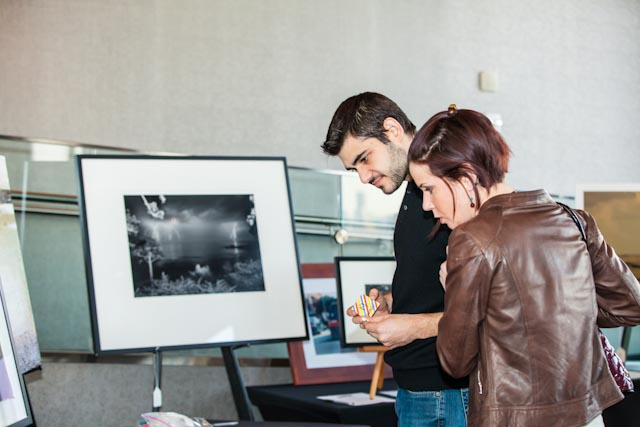 Stuart Shapiro from Binders and his wife check out the silent art auction pieces