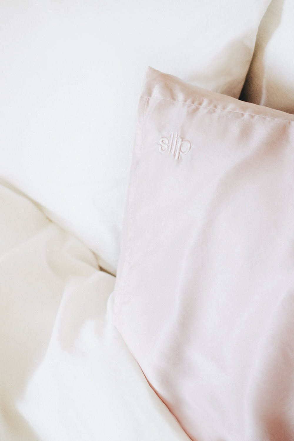Investing in a silk pillowcase - Waking up with sleep creases on your face isn't an attractive look and as I have done many a time, it's even worse when you've rocked up to work with them still there! Sleep creases are actually an indication of damage from sleeping on a cotton pillowcase and when I saw that my sister had a Slip Pure Silk Pillowcase - which came highly rated from her - I decided to invest in one of my own. Having had mine for about six months now, these luxury pillowcases are a treat for both the skin and the hair as they're really gentle and never pull or tug on our delicate features. Sleep creases can turn into wrinkles over time, which the Slip Pure Silk Pillowcase helps prevent and they're even said to be more hydrating. As cotton is more absorbent than silk, this means cotton pillowcases can draw moisture from your skin and take away from our expensive night creams, so if you have a dry skin type like I do, investing in a silk pillowcase is ideal. Silk also breathes a lot better than cotton, meaning it'll keep you cool in summer and warm in the winter. On hot summer nights, I love flipping over my pillows to the cool side, but now I don't need to!