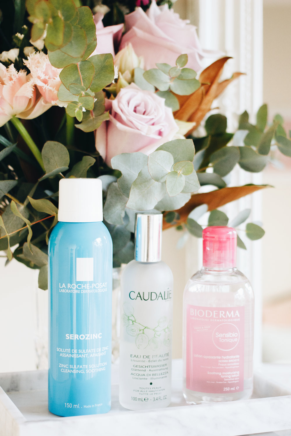 - Caudalie Beauty ElixirMy very first bottle of Caudalie Beauty Elixir was bought back in 2012 at a quaint little Parisian pharmacy. A spritz of this reinvigorating mist instantly takes me back to my summer in Europe and I have to admit, the scent is the main reason why I love this toner so much. Like the Herbivore Rose Hibiscus Hydrating Face Mist, I don't use it in the traditional manner after cleansing, but it's one I keep around for a pick-me-up as it's something really therapeutic, yet energising at the same time. While I did use Beauty Elixir as a proper toner up until a couple of years ago, I stopped when I started looking more thoroughly into skincare ingredients and learning just how damaging things like alcohol and essential oils - which Beauty Elixir contains a lot of - can be. Alcohol is a huge no-no for those who are on the drier side and for that reason, I don't feel comfortable applying this to bare, freshly cleansed skin. As previously mentioned, essential oils can also be irritating, but I can't really complain there since I don't have sensitive skin and they're also why this stuff smells so damn good!Containing a blend of grape, orange blossom, rose, mint and rosemary, I apply Beauty Elixir over makeup or after my whole skincare routine, but I also enjoy simply spritzing it into the air and taking in its refreshing and cooling goodness. It's said to