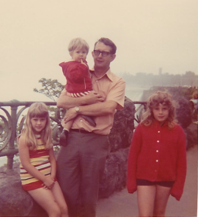 My dad with my sisters and me at Niagara Falls.