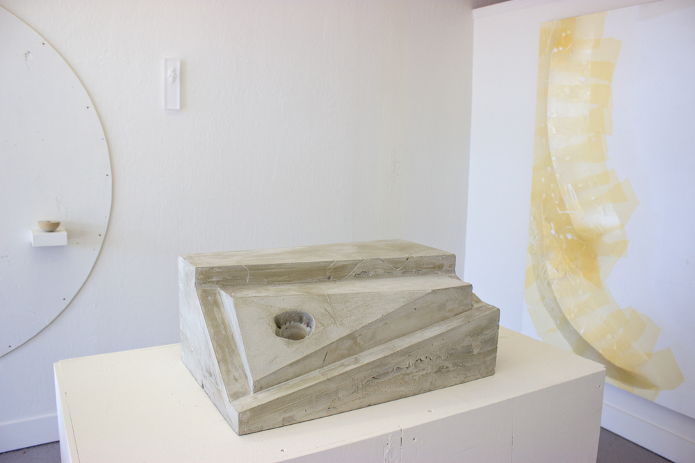Untitled (concrete shell, rectangle)  2015  Cast concrete altered rectangle, embedded decorative shell   10 x 16 x 24 inches