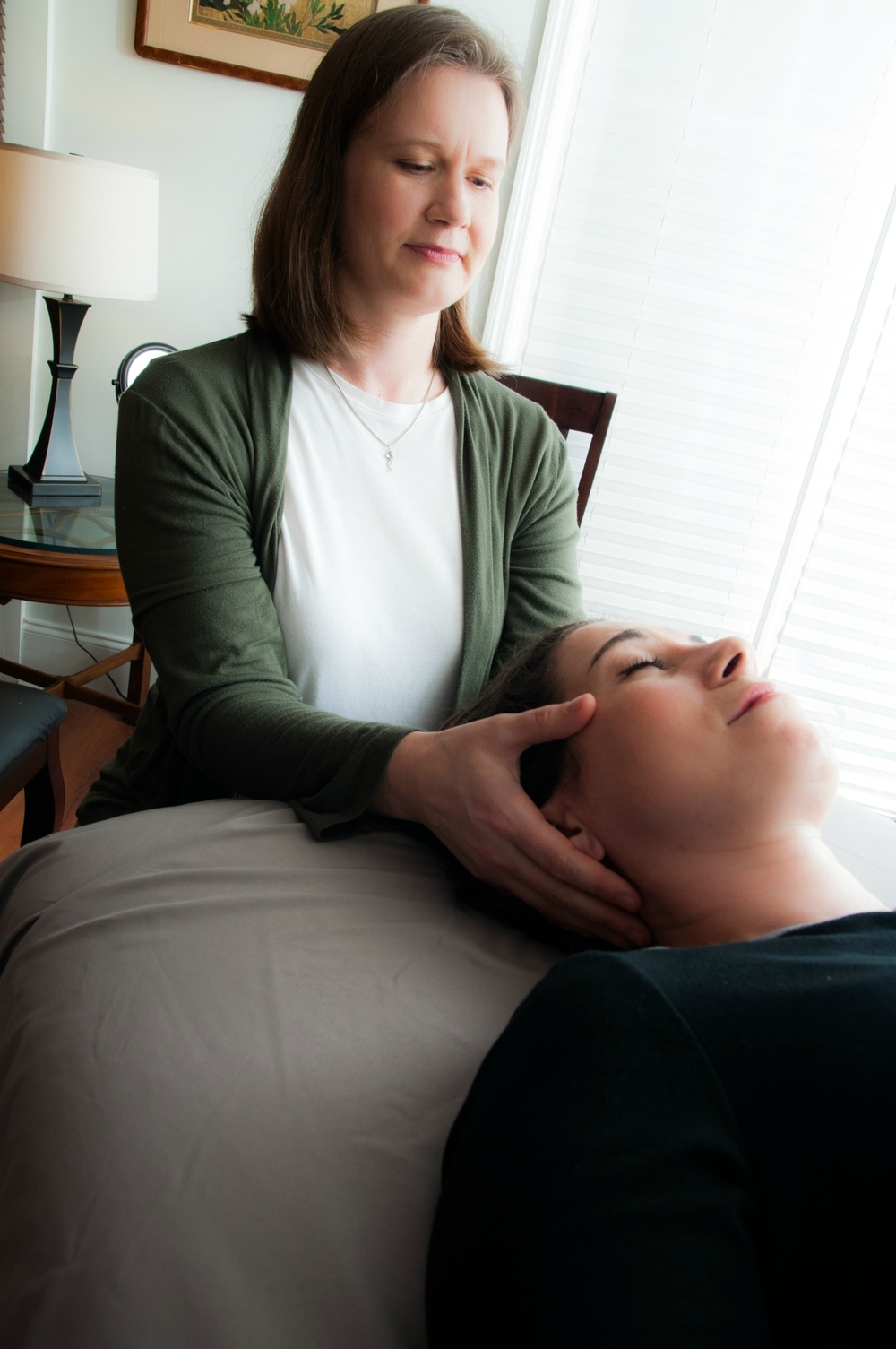Maija Salins, LMT, CST-D, of Wise Bodymind, works with a client in her CranioSacral Therapy practice in metro Atlanta, Georgia.