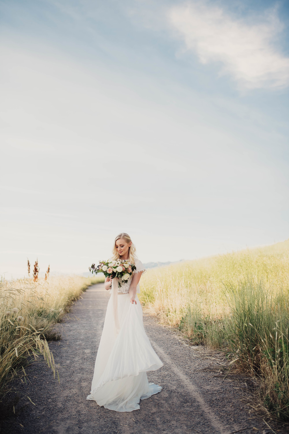 Flowing wedding dress, bride on trail