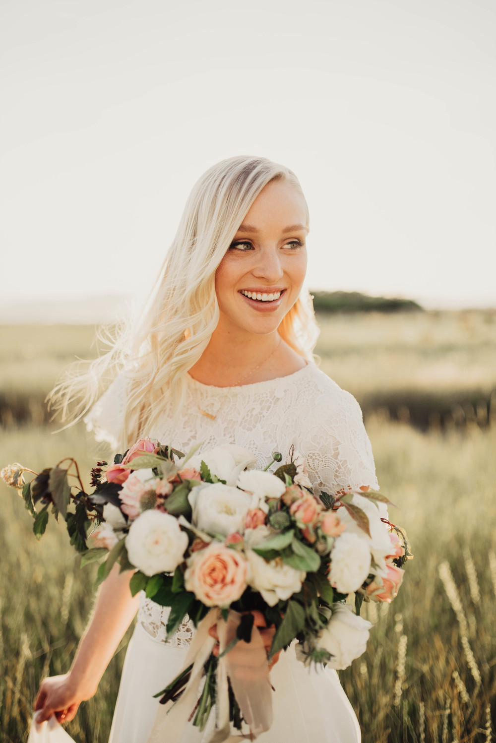 Laughing bride with large bouquet
