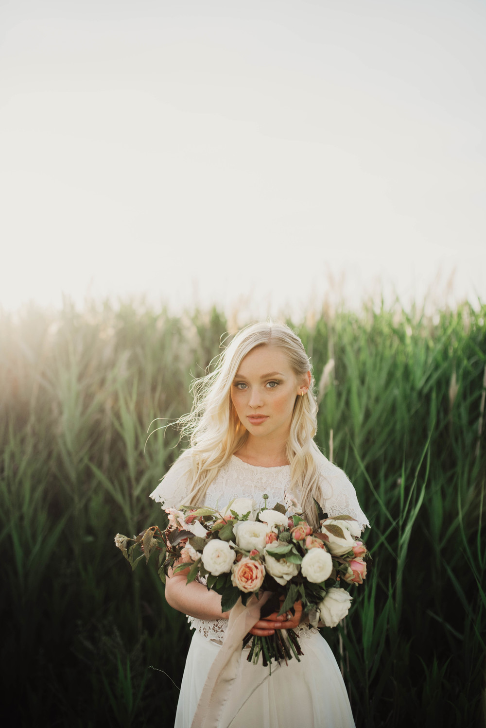 Wind blown bride with bouquet