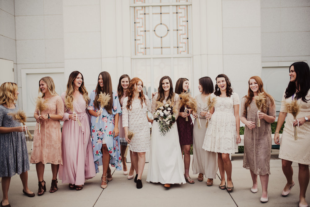 Bridesmaids walking wildflower bouquets.jpg
