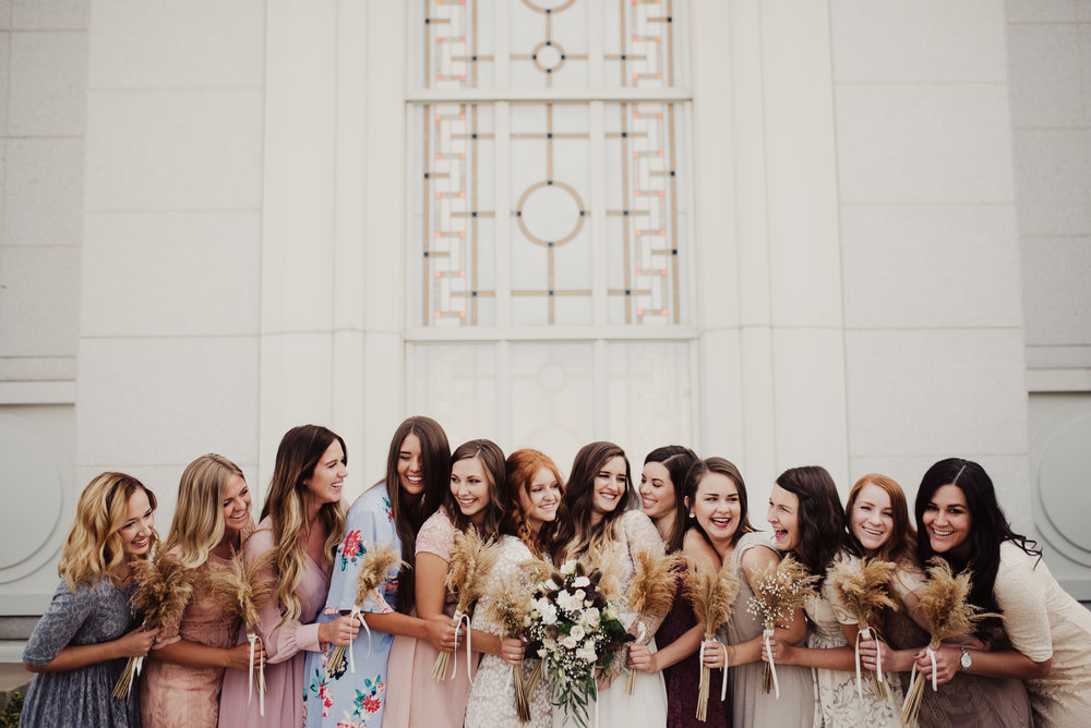 Mismatched wildflower bridesmaids laughing.jpg