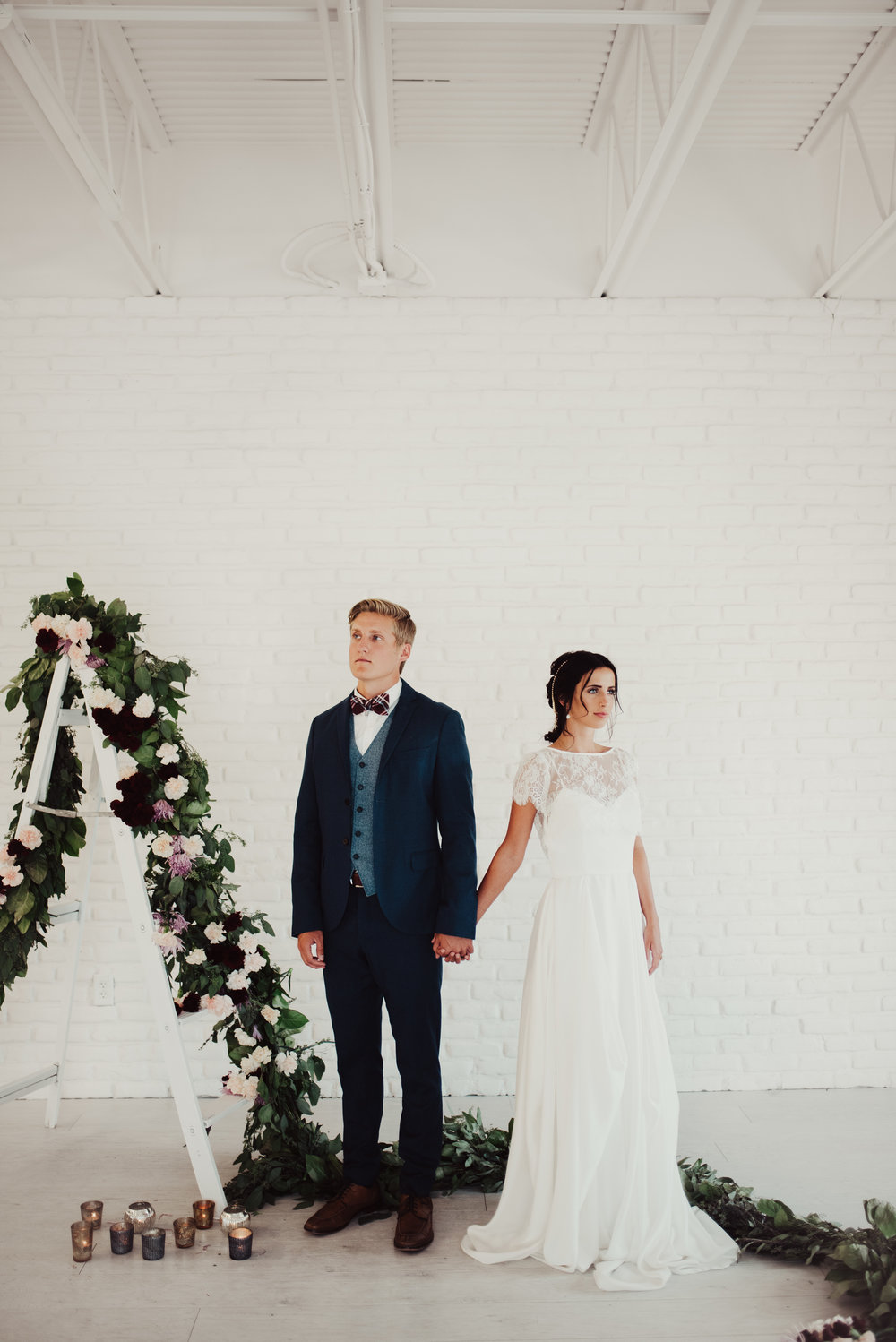 floral-wedding-garland-on-ladder-backdrop.jpg