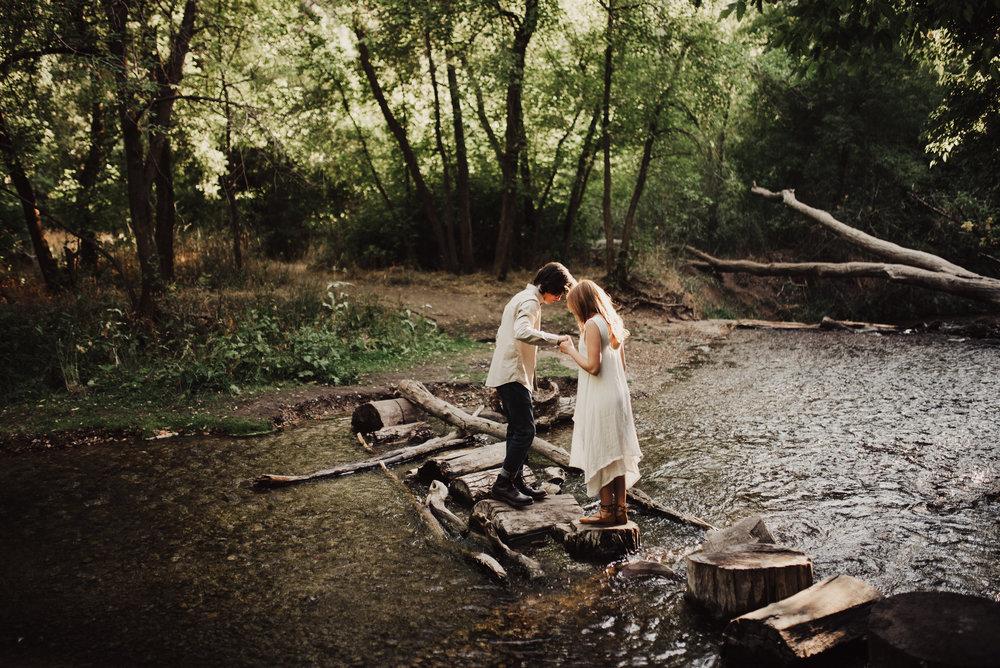 groom-helping-bride-across-river.jpg