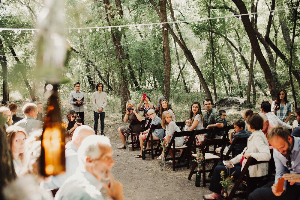 bride-walking-down-the-isle-wedding-in-the-woods.jpg