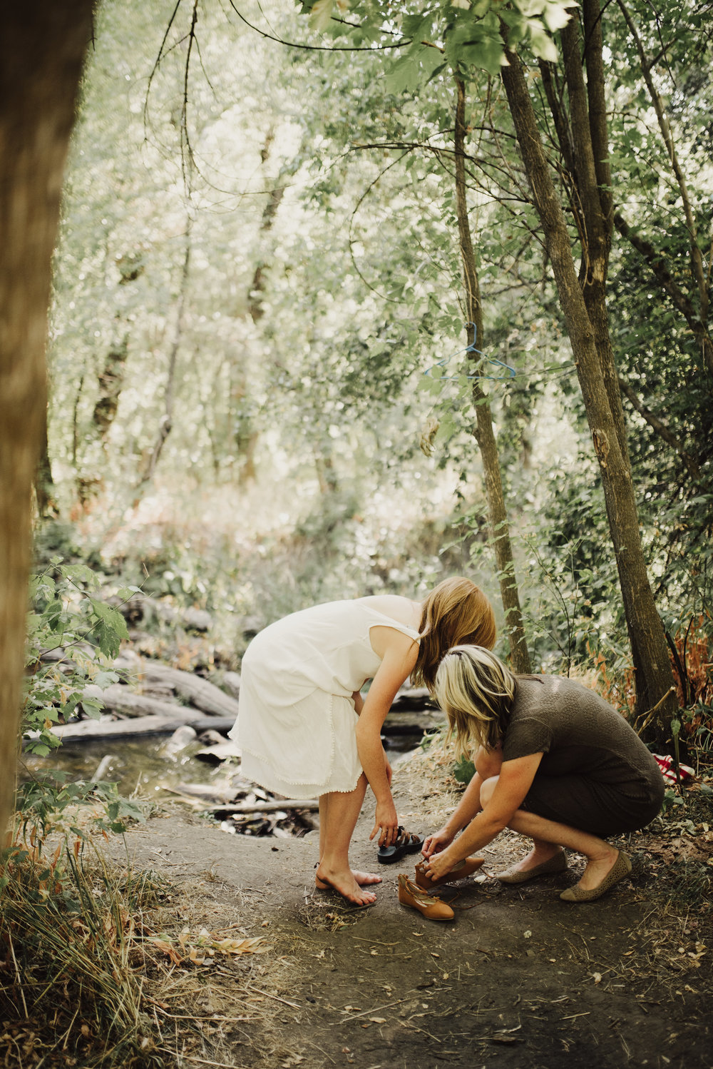 mother-and-bride-getting-ready-in-woods.jpg