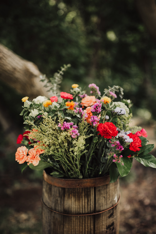 wildflowers-in-wooden-bucket-wedding-details.jpg