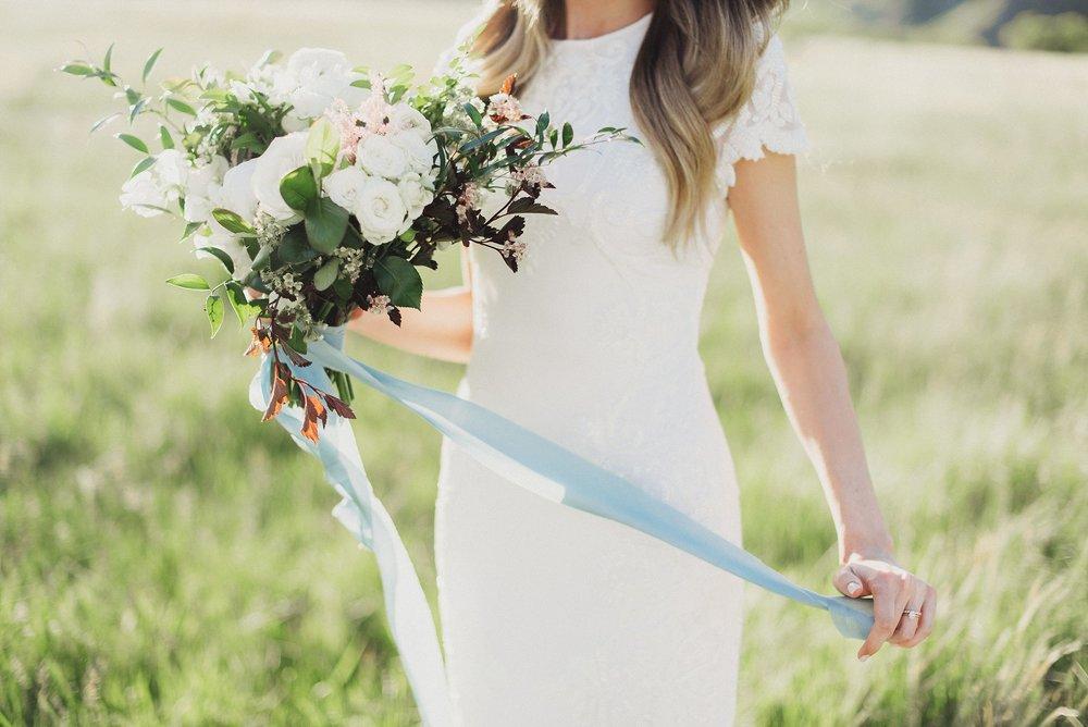 Madison Murdock Bouquet Beaded Wedding Dress