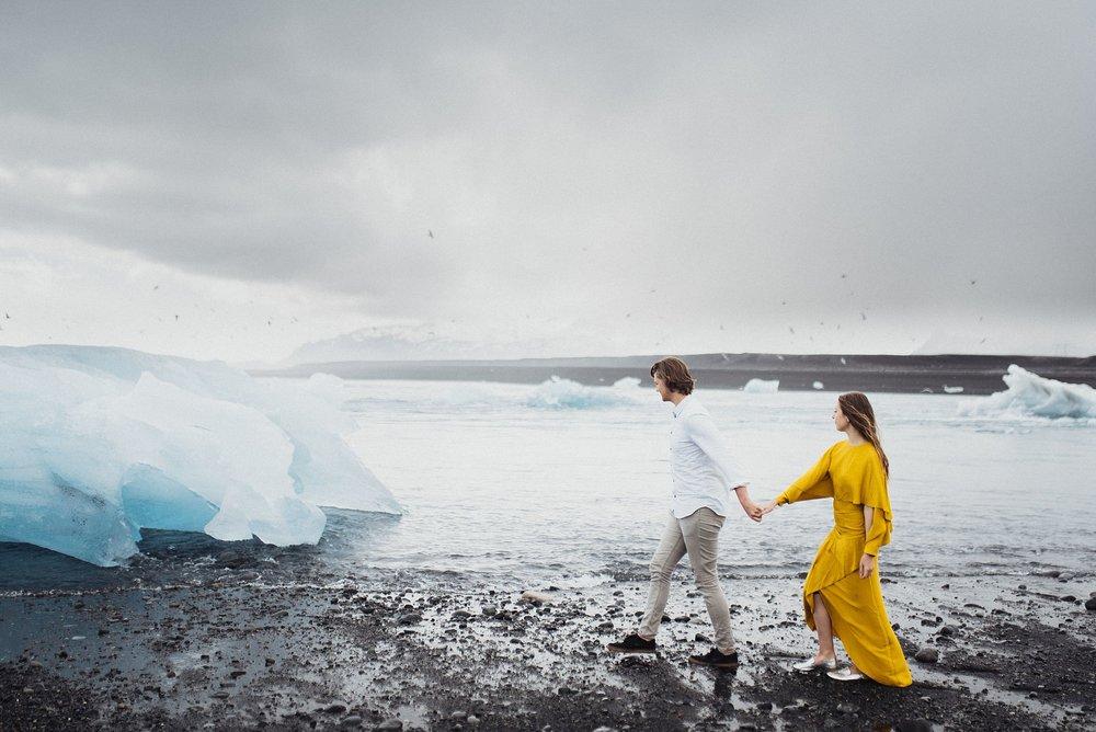 couple at diamond beach iceland