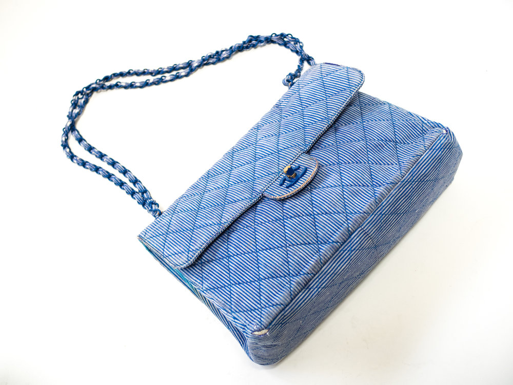 Chanel Striped Blue Quilted Purse Condition: Fading & wear due to age, which is why we love it even more. Its like Chanel and workwear had a baby. Truly one of a kind and fits our aesthetic perfectly. (swoon)