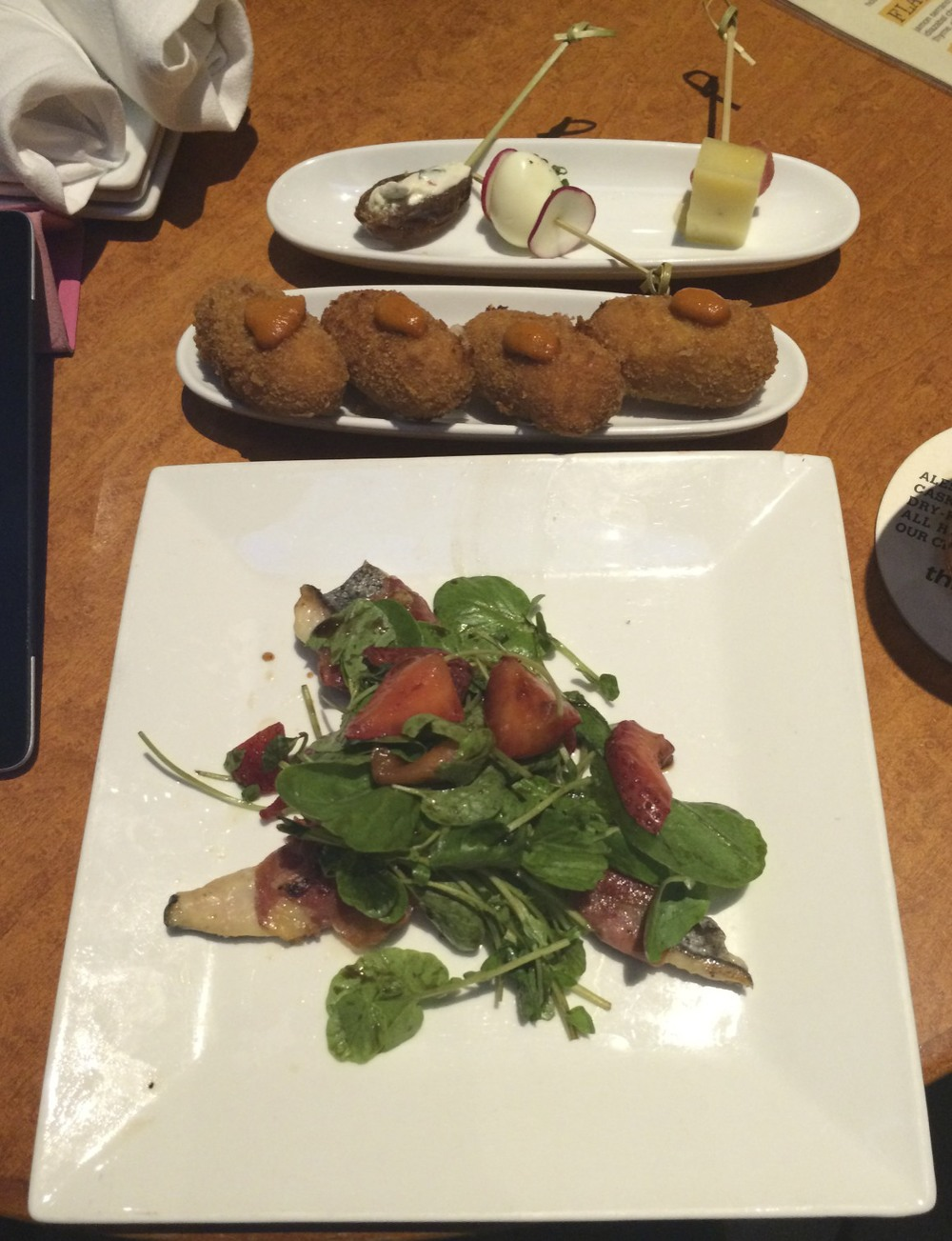 Top: Fig stuffed with goat cheese skewer, quail egg and radish skewer, and manchego, rhubarb and honey skewer Middle: Croquettas with Romesco sauce Bottom: Jamón wrapped halibut with greens and strawberries