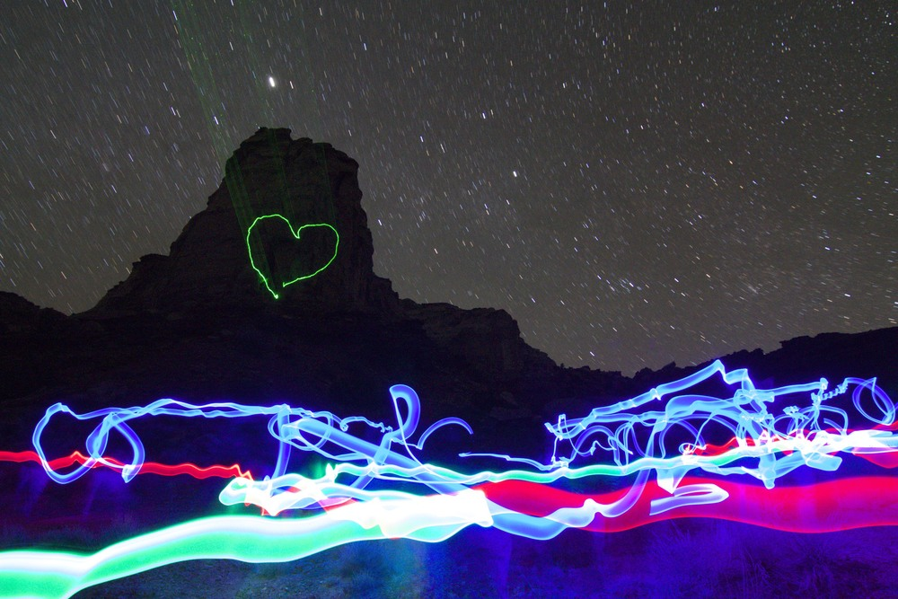 Vader Rock at night, painted with light. Nathaniel and I ran around with glow sticks while leaving the shutter open.