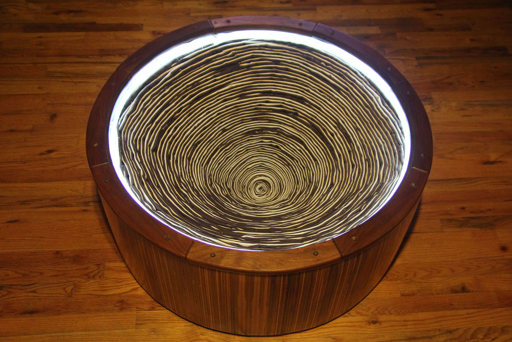 13 - Funnel coffee table with neon and stuffed with white and brown canvas.jpg