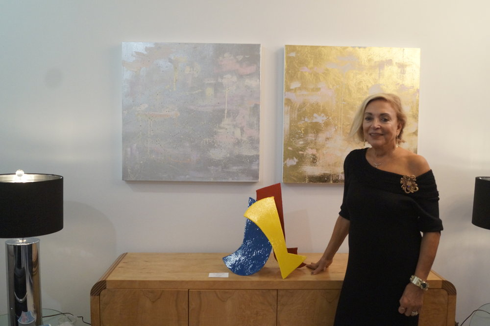 Isabella with some of the work on display in her new gallery.