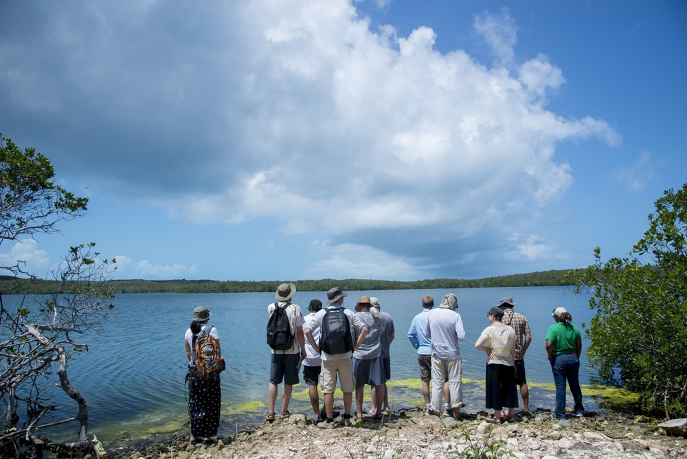 The Kinship Conservation Fellows group assesses Turtle Lake.  Spring 2013.  Photo courtesy of Neil Ever Obsborne and iLCP.