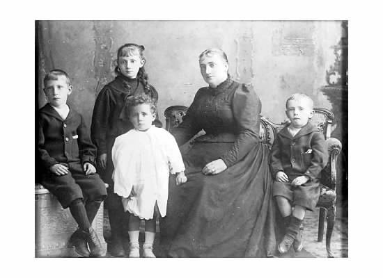 Mary-Jane Heenan seen here with her children.  James on the far left took over from his mother after she died.