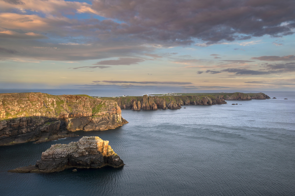 The sun-kissed cliffs of Tory Island, shortly after sunrise.