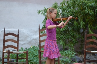 An Instrumental Story Tellers performance at the Electric Ladybug Community Garden.