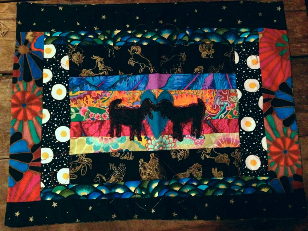 quick i-phone picture i took of this quilt i made for another two dear friends who got wedded this summer. they fell in love over their mutual passion for italian goat farming. you know how it is.
