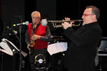 "Performing with Paquito D'Rivera (featured in red, next to trumpeter Diego Urcola) requires ""passion, seriousness, and respect for what you play,"" says Berklee Latin Jazz Program academic director Oscar Stagnaro."