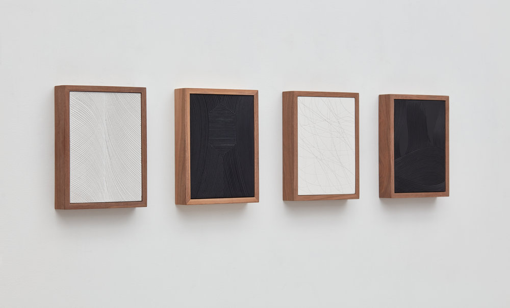 """Untitled (Four Part Etched Plaster),"" (2017). Pigmented hydrocal, walnut frames. Courtesy David Kordansky Gallery."