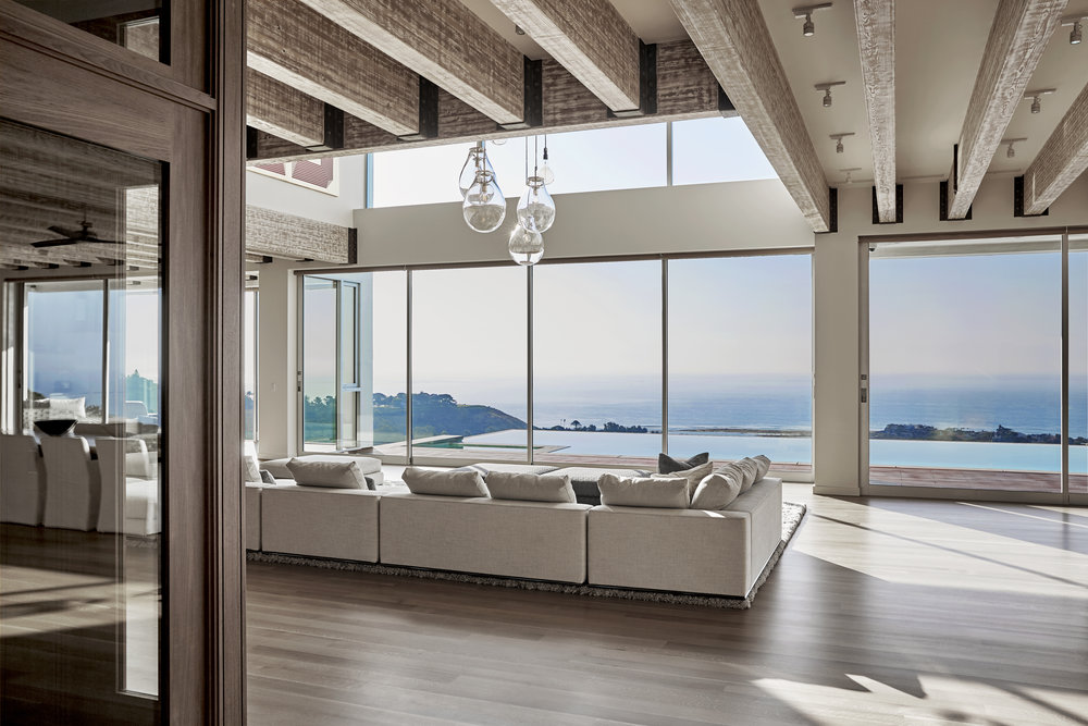 "The ""New Castle"" living room affords sweeping ocean views."