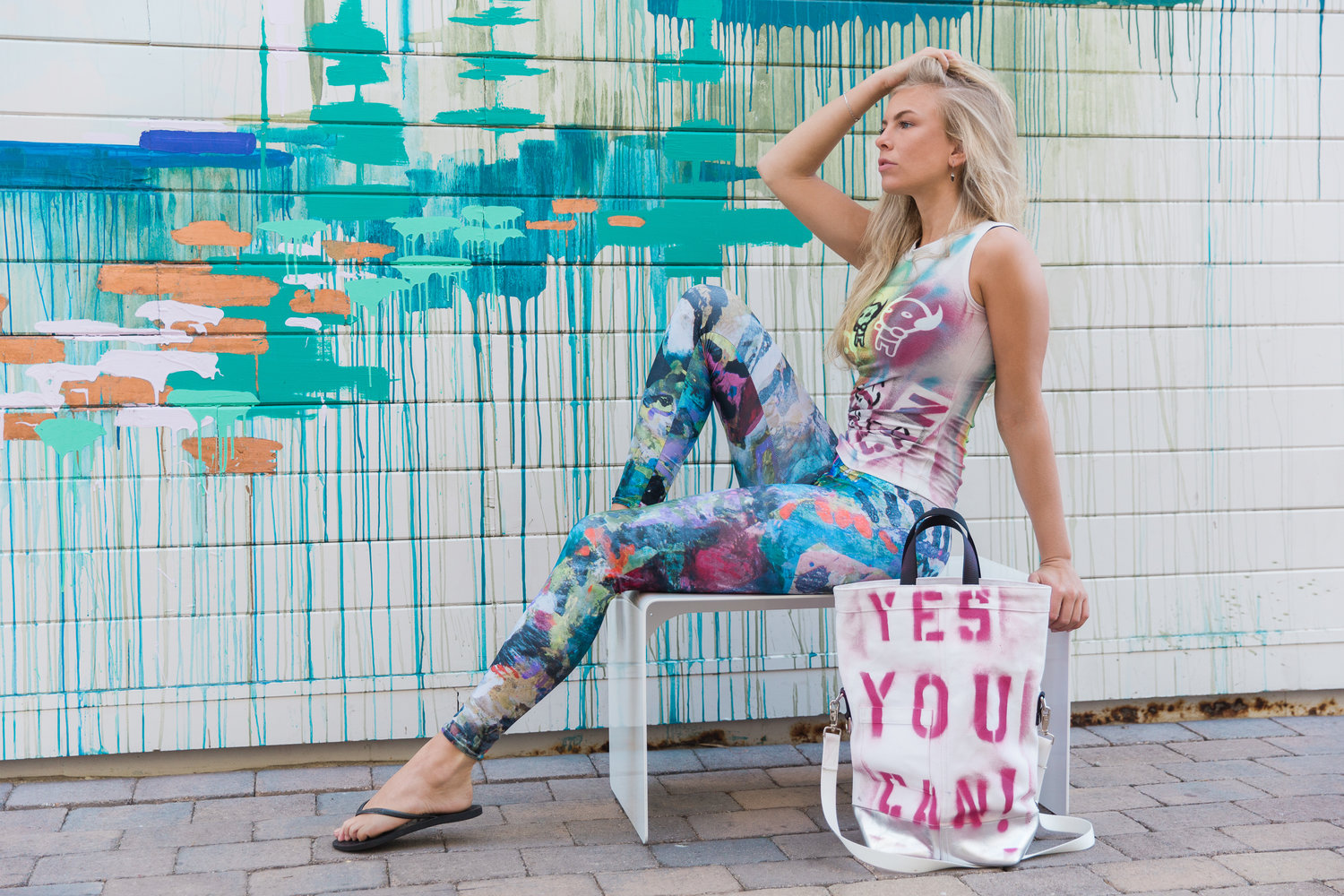Chester Wallace canvas tote ($350), White muscle T-shirt ($269), Sumatra Reef leggings ($125)